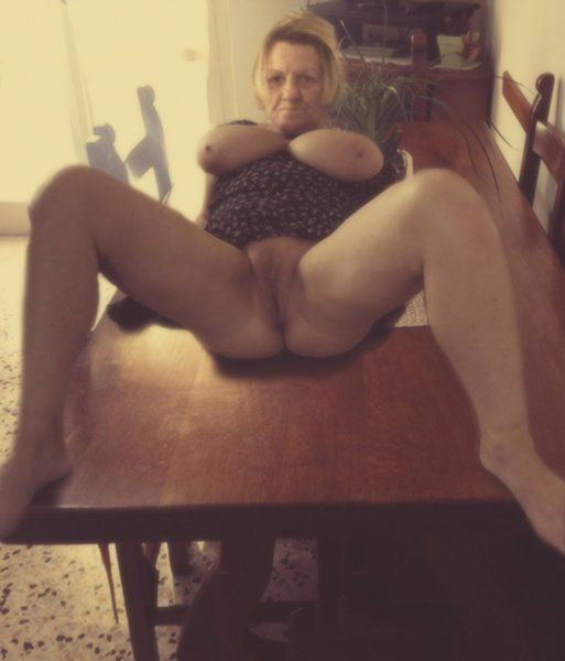 spreading legs mature slut flashing bigtits and pussy on kitchen table